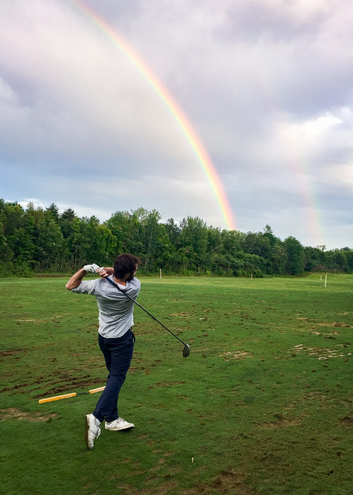 Torrey enjoys teeing off to a double rainbow at the North Conway Country Club.